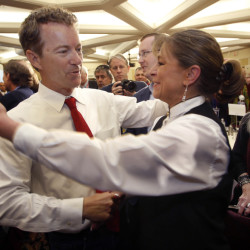 Republican presidential hopeful Sen. Rand Paul, R-Ky., gets a hug after speaking at the Republican Leadership Summit on Saturday in Nashua, N.H.