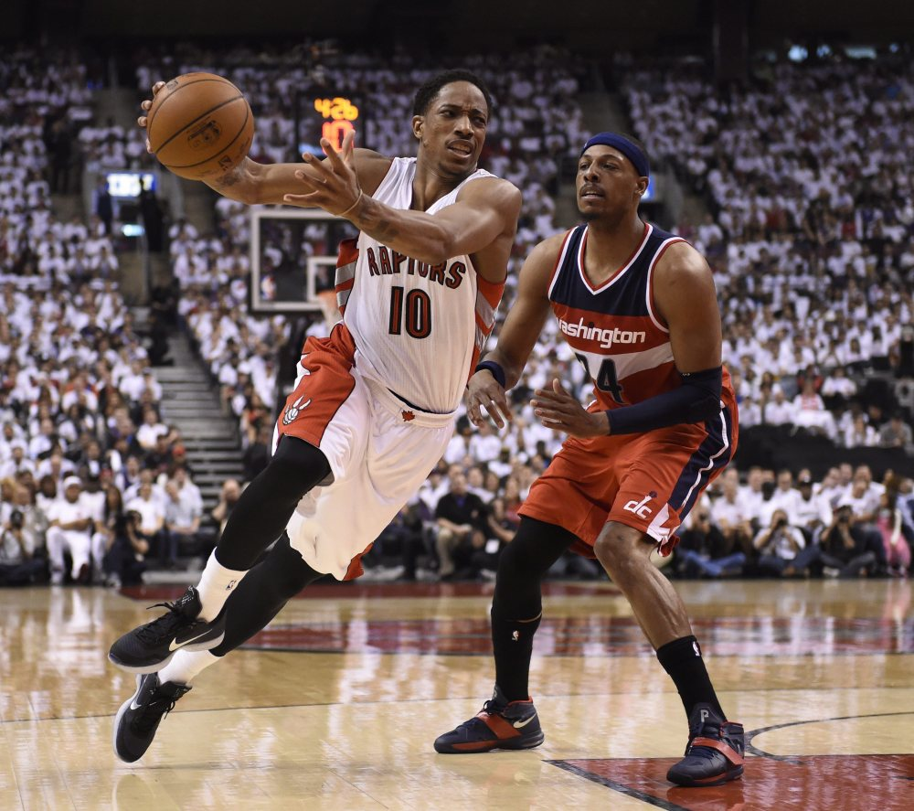 DeMar DeRozan of the Raptors is fouled by Washington's Paul Pierce in first half Saturday in Game 1 of their playoff series at Toronto. The Wizards won in overtime, 93-86.