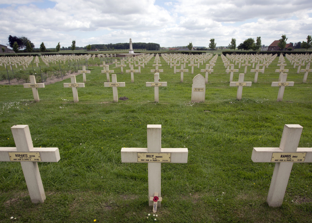 Graves of French and French colonial World War I soldiers are seen at the Saint-Charles de Potyze Cemetery in Zonnebeke, Belgium. More than 90,000 soldiers were killed by poison gas during that war. The Associated Press