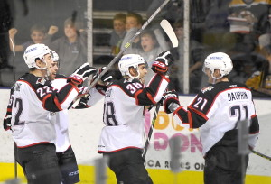 Laurent Dauphin, right, celebrates with his teammates after scoring Portland's second goal Saturday night in a 3-2 over the Providence Bruins at Cross Insurance Arena.