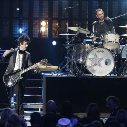 Ringo Star and Billie Joe Armstrong of Green Day perform at the Rock and Roll Hall of Fame induction ceremony Saturday night in Cleveland.