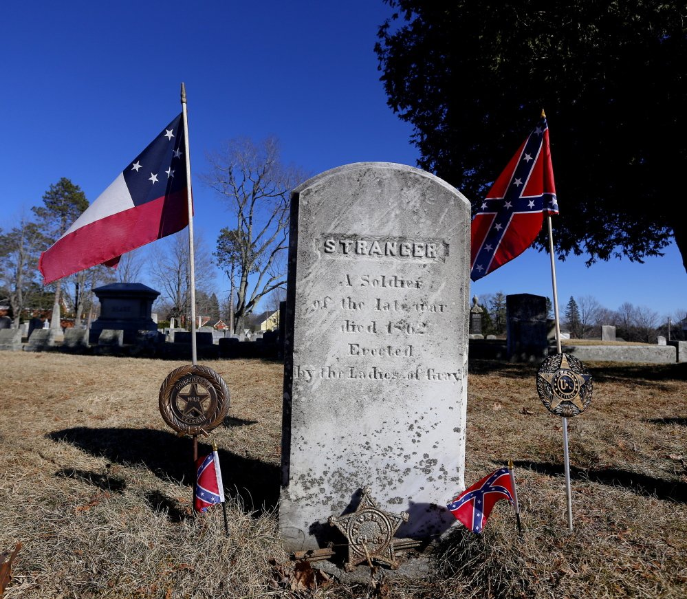 """A headstone engraved """"Stranger"""" marks the grave of an unknown Confederate soldier in the Gray Village Cemetery. The grave site was supposed to be for Lt. Charles H. Colley, whose final resting spot is unclear. The unknown soldier's grave is marked by small Confederate flags, a gesture first requested in the 1950s by a Georgia resident."""
