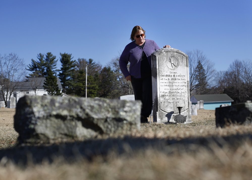 Debi Curry, an employee of the town of Gray and member of the historical society, stands by the memorial for Union soldier Charles Colley.