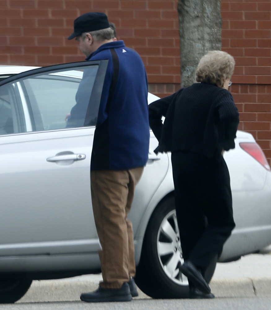 John Hinckley gets into his mother's car in front of a recreation center in Williamsburg, Va. For the past year, Hinckley has spent 17 days a month at his mother's home.