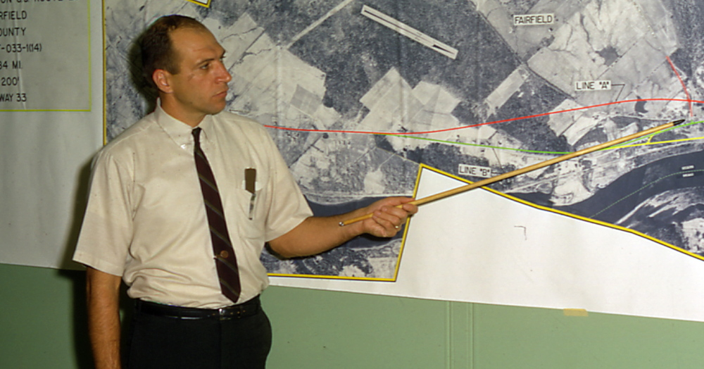 Richard Coleman of Augusta points to a map this 1968 photo provided by the Maine Department of Transportation. He has had a hand in many major construction projects over the years, prompting the Legislature to name I-295 after him.
