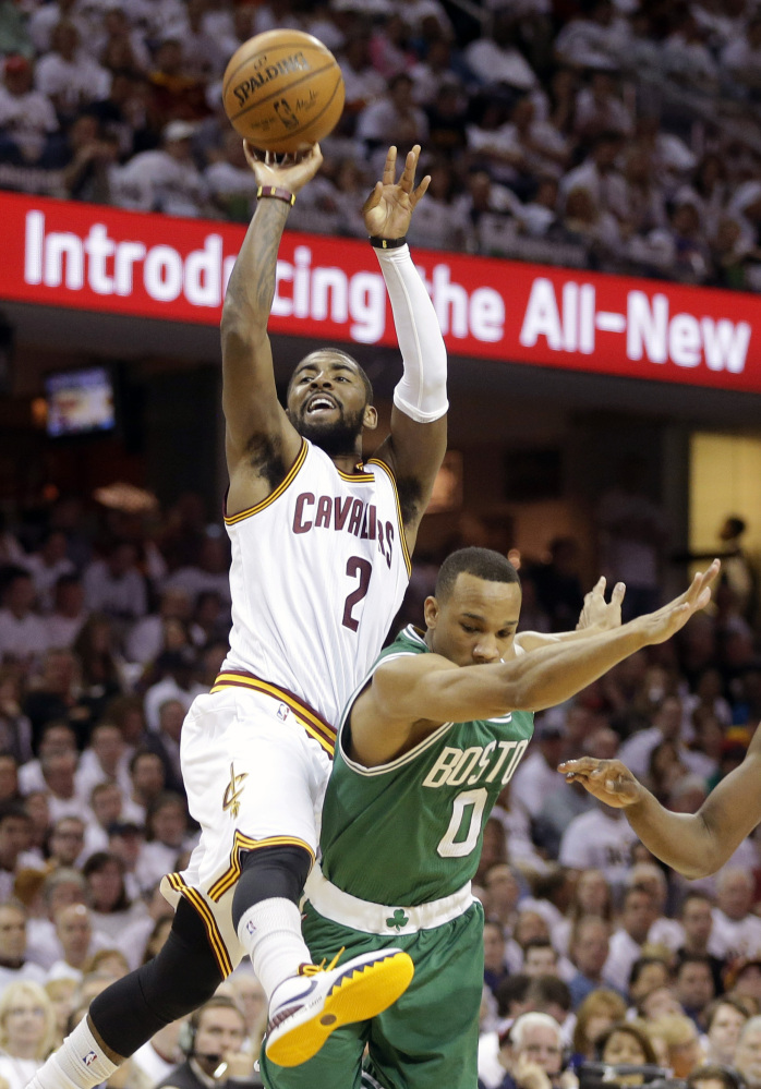 Kyrie Irving of the Cavaliers is fouled by Boston's Avery Bradley during Sunday's game in Cleveland. Irving made the shot on the way to a 30-point performance as Cleveland grabbed a 1-0 series lead.