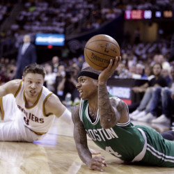 Isaiah Thomas of the Celtics looks for an open teammate after a collision with Cleveland's Matthew Dellavedova. Thomas led Boston with 22 points. The Associated Press