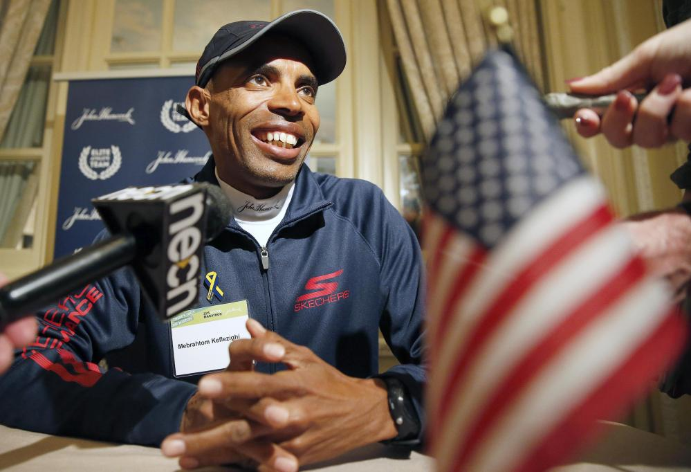 Long distance runner Meb Keflezighi talks with reporters during a news conference, Friday in Boston. The 119th Boston Marathon will be run Monday. The Associated Press