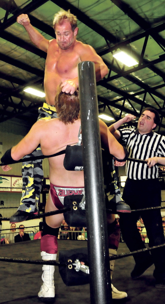 Westbrook's Scott Garland, known professionally as Scotty 2 Hotty, winds up to land a blow against opponent Sean Burke.