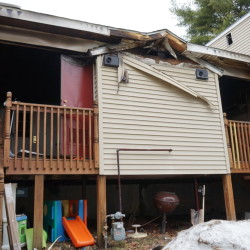 The back porches and an electrical utility room show burn marks after a Sunday night fire at 70 Grandview Ave. in South Portland.