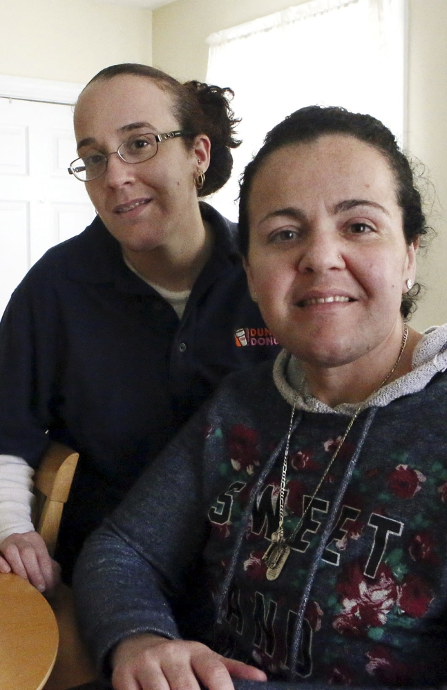 Susane Nunes, left, who is cancer-free, and her sister Dee Noonan, diagnosed with cancer, both chose to undergo surgeries. They share a family history that puts them at high risk for the disease.