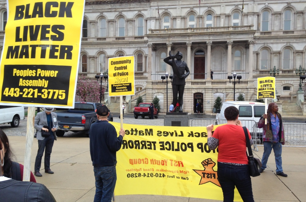 Demonstrators protest the death of Freddie Gray outside Baltimore City Hall on Monday. Gray died Sunday, a week after he was rushed to the hospital with spinal injuries after an encounter with police.