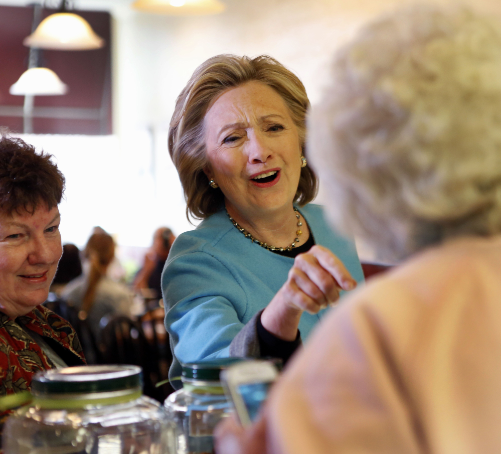Democratic presidential candidate Hillary Rodham Clinton speaks to Doreen A. Boyea during a campaign stop  at Kristin's Bakery on Monday in Keene, N.H.