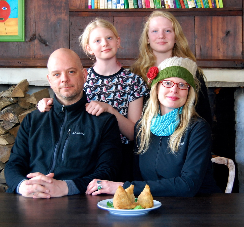 In the Ellingsworth home in Portland, parents, John and Christy, eat vegan, while daughters Georgia and Madison eat meat. Christy looks for foods they all can enjoy, such as the samosas from Shere Punjab in Brunswick. Contributed photo