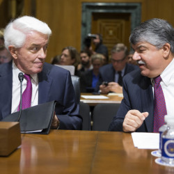 "AFL-CIO President Richard Trumka, right, talks with U.S. Chamber of Commerce President Tom Donohue on Tuesday. Major labor unions and business groups clashed over President Obama's bid for ""fast track"" authority to advance trade deals."