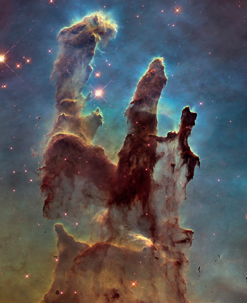 A Hubble-provided image of the Eagle Nebula's Pillars of Creation.