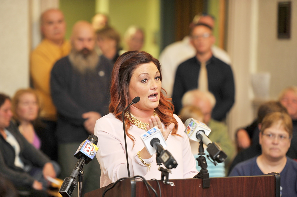 (FILE) Mellisa Luedke, seen speaking on April 21 at a public discussion of allegations of sexual abuse by two former Biddeford police officers, submitted a petition under a provision of the city charter that will compel the City Council to hold another hearing on the issue.