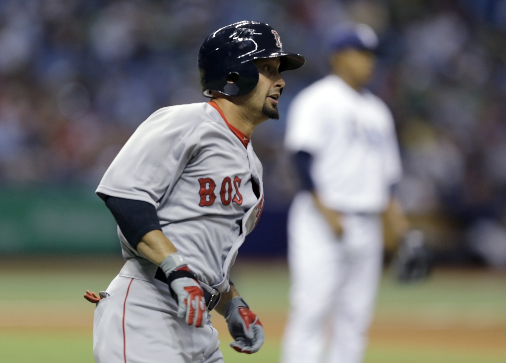 Boston Red Sox's Shane Victorino watches his double off Tampa Bay Rays relief pitcher Jose Dominguez in Tuesday's ninth inning. The Associated Press
