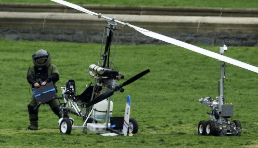 A member of a bomb squad checks the small helicopter that Doug Hughes landed on the U.S. Capitol lawn last week in an apparent effort for campaign finance reform.