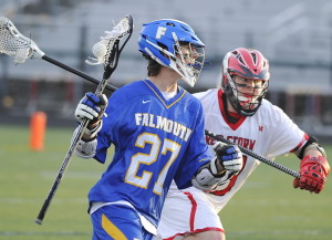 Falmouth's Bryce Kuhn rushes past Scarborough's Kevin Caldwell in Wednesday's game. Kuhn had four goals and an assist as the Yachtsmen improved to 2-0.
