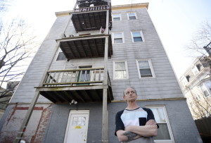 """Bert Stain, standing at the back of 563 Cumberland Ave., where Donald Stain died after falling from a third-floor porch, said his brother complained to him about the porch railing """"three or four times"""" while living there but never filed a complaint with the city."""