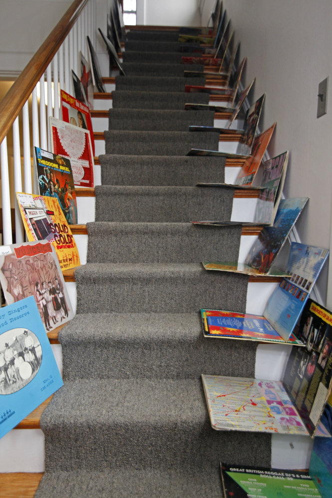 "Record sleeves dry on stairs in a nearby building after a water pipe burst in WMPG's studios at USM Wednesday night, soaking blues and other records, many ""irreplaceable."" Up to 20 percent of the station's vinyl library was damaged."