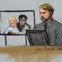 In this courtroom sketch, Boston Marathon bombing survivor Steve Woolfenden is depicted on the witness stand beside a photo of his injured son Leo being carried to safety during the penalty phase in the trial of Boston Marathon bomber Dzhokhar Tsarnaev.
