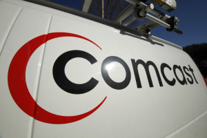 Comcast logo appears on one of the company's vehicles in Pittsburgh.