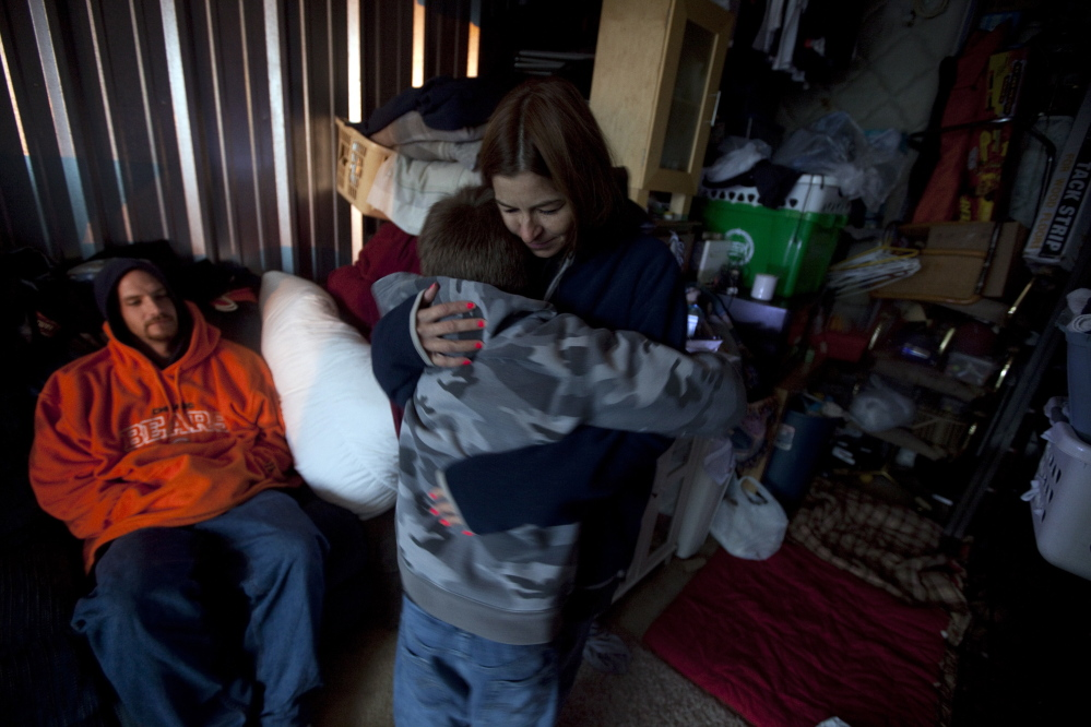 Maria Maior hugs her 12-year-old son inside the storage unit that was their home in 2009 in a Chicago suburb. Homelessness among the nation's public school students rose 58 percent between the 2007-08 and 2012-13 school years.