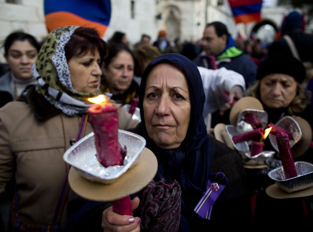 Armenian women in Jerusalem hold torches during a march on Thursday to commemorate the 100th anniversary of what many call the first genocide of the 20th century – in 1915 the Ottoman government began the systematic extermination of its Armenian minority.  The Associated Press