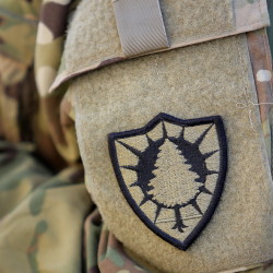 A pine tree uniform patch shows this Army National Guard member serving in Afghanistan is part of Maine's 133rd Engineer Battalion.