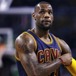 Cleveland Cavaliers forward LeBron James pulls up his sleeve while facing the Boston Celtics in the first quarter of a first-round NBA playoff basketball game in Boston on Thursday.