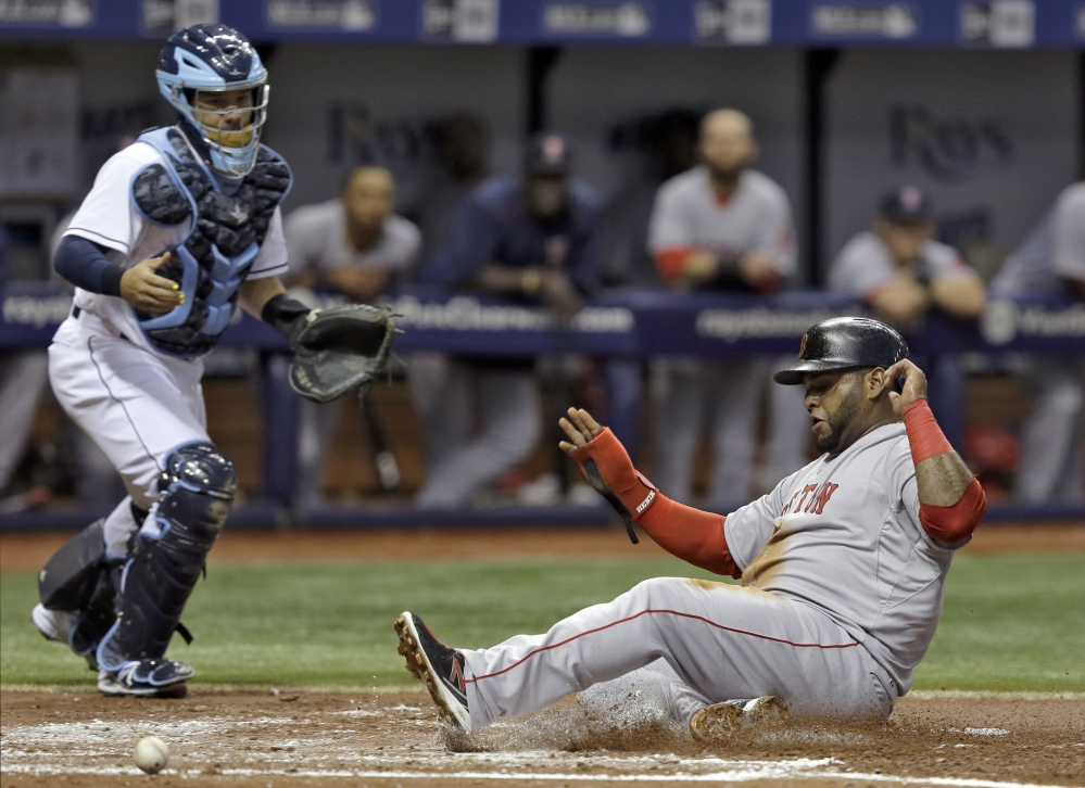 Red Sox third baseman Pablo Sandoval scores on a sacrifice fly by Daniel Nava off Tampa Bay Rays starting pitcher Jake Odorizzi in the second inning of Thursday's game in St. Petersburg, Fla. Catching for the Rays is Rene Rivera.