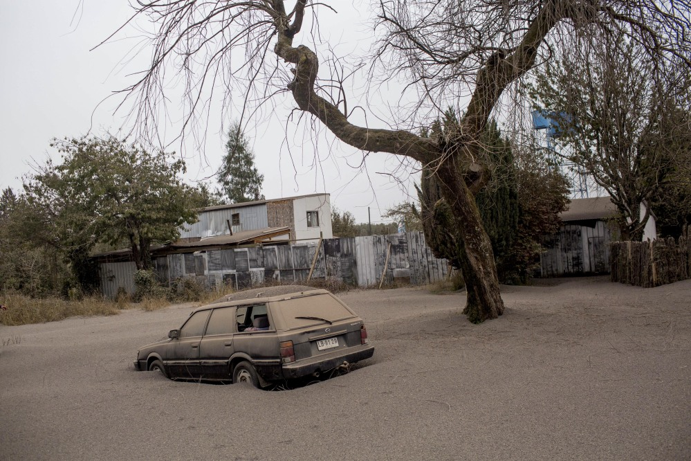 A car is covered in ash left behind by the eruptions of the Calbuco volcano in Ensenada, Chile, on Thursday.