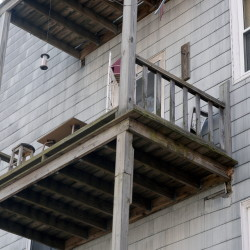 The second-floor apartment porch at 563 Cumberland Ave. in Portland where Donald Stain fell. Shawn Patrick Ouellette/Staff Photographer