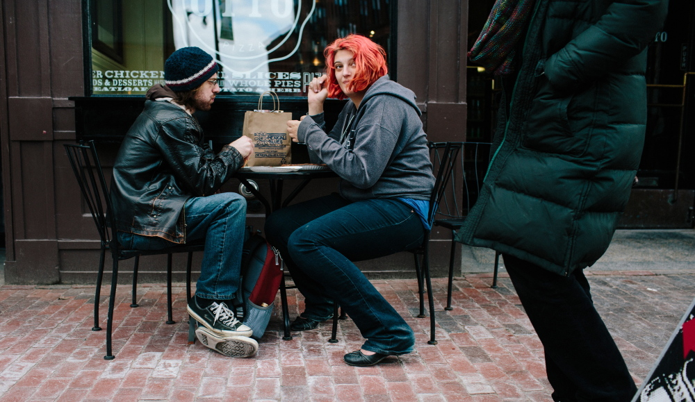 Ben Frost, left, and Channa Schroff eat at Otto Pizza along Congress Street in Portland on Friday. The city revised its guidelines for outdoor dining areas in response to complaints from parents pushing strollers, people in wheelchairs and others.
