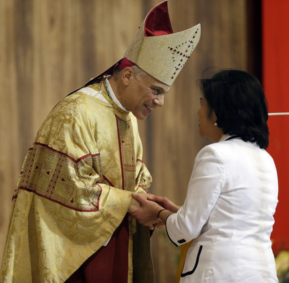Archbishop Salvatore J. Cordileone, seen greeting a congregation member at the Cathedral of St. Mary of the Assumption in San Francisco, has prompted local Catholics to publicize their complaints about his traditional views.