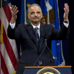 Attorney General Eric Holder acknowledges  applause of Justice Department employees as he ends his farewell speech in Washington on Friday.
