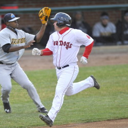 Tim Roberson of the Portland Sea Dogs heads down the line to score as Trenton third baseman Eric Jagielo waits for a throw Friday night.