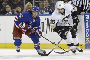 The Rangers' Carl Hagelin and the Penguins' Brandon Sutter fight for control of the puck during the Rangers' 2-1 overtime win in Game 5 at Madison Square Garden.