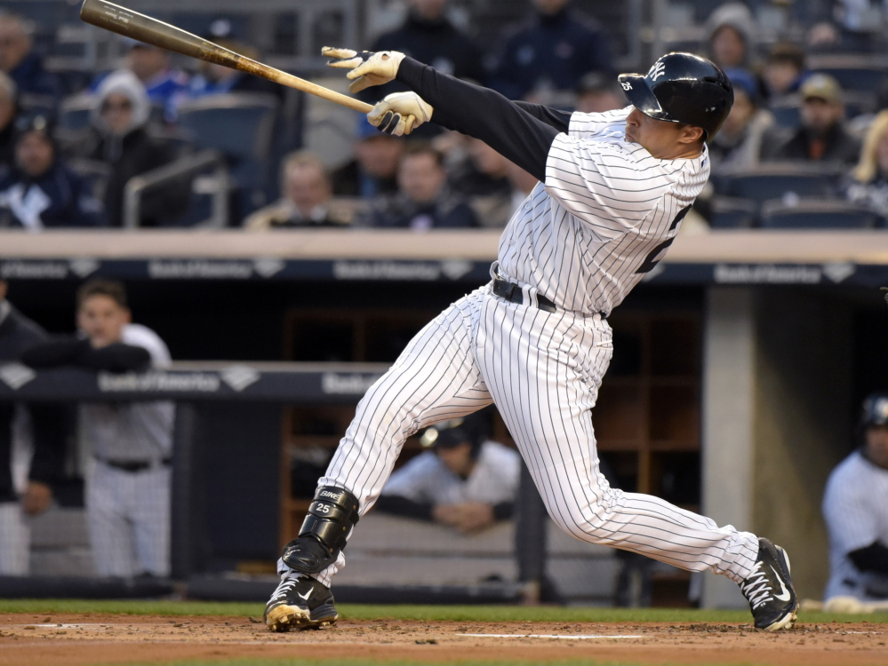 Mark Teixeira hits a two-run home run during the Yankees' 6-1 win over the Mets Friday at Yankee Stadium.