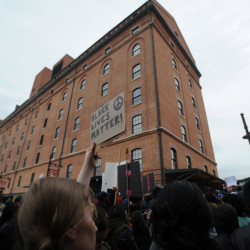 Protestors rally at Oriole Park at Camden Yards during a march for Freddie Gray, Saturda