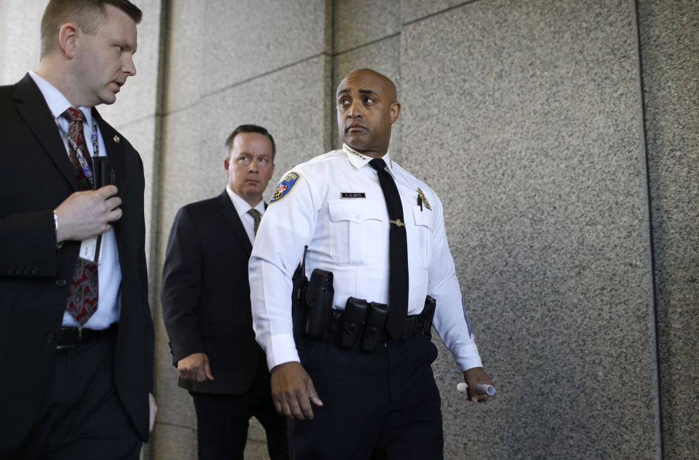 Baltimore Police Department Commissioner Anthony Batts, center, leaves a news conference after speaking about the investigation into Freddie Gray's death, on Friday.