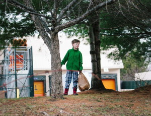 Rocco Sullivan, 8, picks up trash in the area around Clark Pond behind Home Depot with his brothers' Boy Scout troop in South Portland on Saturday.