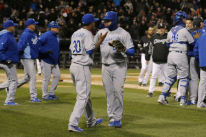 Kansas City Royals starting pitcher Yordano Ventura is pulled aside by teammate Mike Moustakas as the benches clear during the seventh inning against the Chicago White Sox on Thursday.
