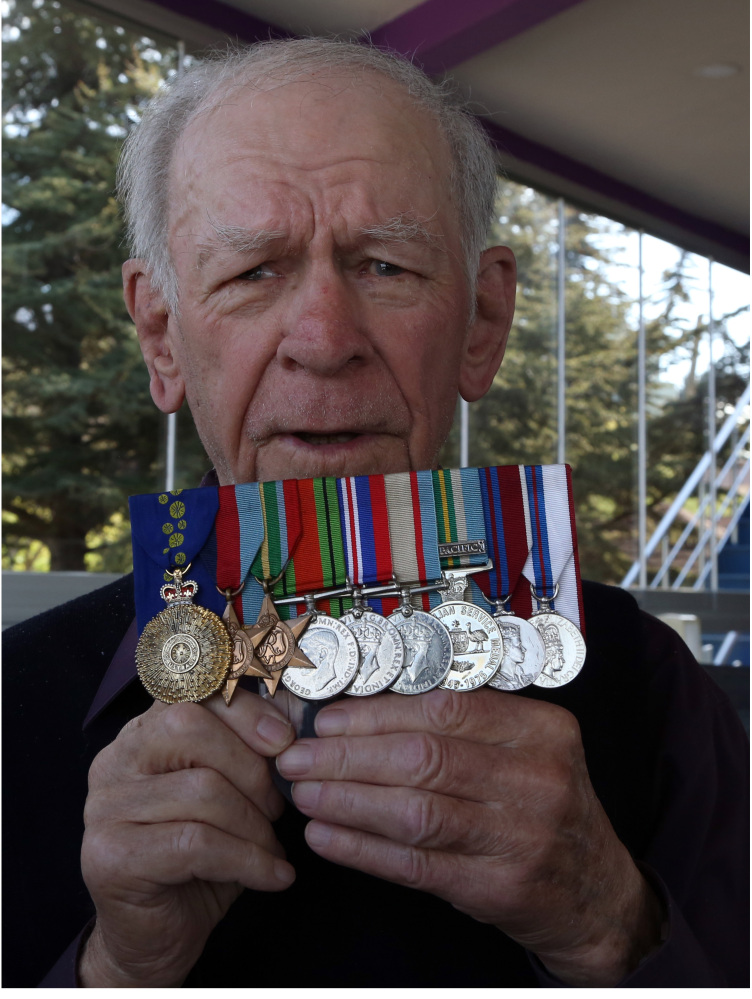 Bill Grayden shows his medals as he speaks to The Associated Press in Gallipoli, Turkey, on Friday. For the first time at age 95, Grayden went to Gallipoli, where his father stormed the beach and took a bullet through his lung during the ill-fated British-led World War I invasion.