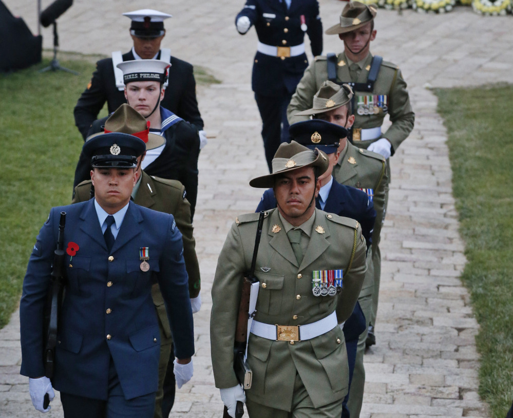 Military personnel parade at the Anzac Cove commemorative site in Gallipoli early Saturday, a century after the ill-fated British-led World War I invasion.