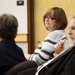 Genevieve Kelley, center, looks back at her lawyers during a hearing in Coos County Superior Court in Lancaster, N.H. Kelley is charged with fleeing the country with her young daughter during a custody dispute.