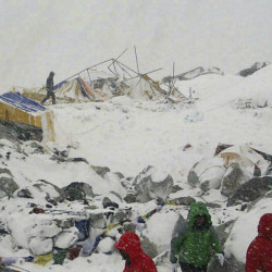 Everest Base Camp is in shambles after an avalanche rushed through the Khumbu Icefall above, leaving an unknown number of climbers and guides dead or missing Saturday.