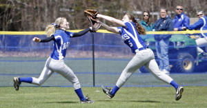 Kennebunk center fielder Hayley Morais, left, and right fielder Kylie Defeo chase a fly ball that was caught by Defeo during Saturday's softball game against Cape Elizabeth, which won 10-9 in extra innings.